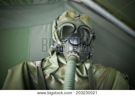 Close up of biological warfare suit .