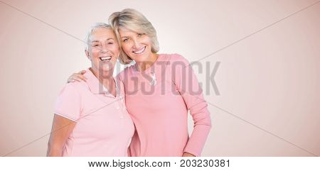 Portrait of happy daughter with mother supporting breast cancer awareness against neutral background