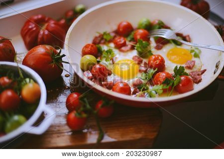 Fried Eggs With Mixed Vegetables In A Frying Pan