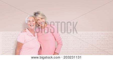 Portrait of happy daughter with mother supporting breast cancer awareness against white wall