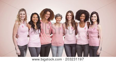 Happy multiethnic women standing together with arm around against neutral background