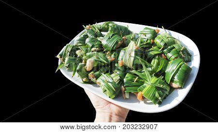 Chicken wrapped pandan raw for fried of Thai food background isolate black color and clipping paths Nice shot of nature concept to save world has copy space.
