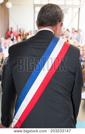 a french mayor during a wedding ceremony