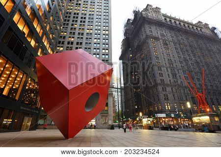 NEW YORK CITY - AUGUST 24: Red Cube Sculpture on August 24 2017 in New York City USA. The sculpture is located in front of 140 Broadway between Liberty and Cedar Streets.