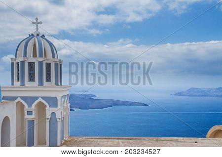 white  and blue belfries against volcano caldera, beautiful details of Santorini island, Greece