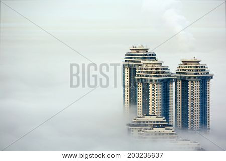 MOSCOW, RUSSIA - SEP 26, 2014: Residential complex Sparrow Hills (Vorobyovy Gory) in morning fog. Complex located on the right bank of the Moskva River.