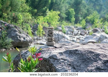 Stones pyramid on rock symbolizing stability zen harmony balance.