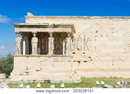 famous facade of Erechtheion temple in Acropolis of Athens, Greece