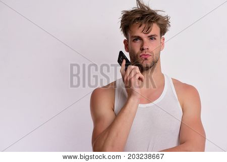 Technology And Modern Lifestyle Concept. Man Holds Gadget