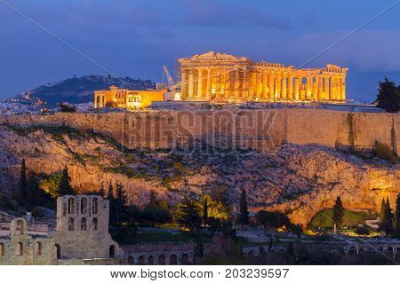 Famous skyline of Athens with Acropolis hill and Pathenon illuminated at night, Athens Greecer