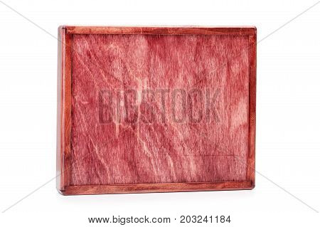 A close-up picture of a wine-colored wooden box isolated on a white background. Closed empty container. A device for delivering of small items. Cargo delivering. Business concept. Copy space.