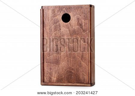A close-up picture of a dark chocolate wooden box isolated on a white background. Closed empty container. A device for delivering of small items. Cargo delivering. Business concept.