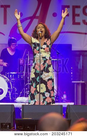 Minsk Belarus-August 12 2017: Vocalist and Singer Pat Appleton of World Renowned Jazz Ensemble De-Phazz Performing at A-Fest Music Festival on August 12 2017 in Minsk Republic of Belarus.