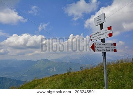 A signpost on the peak of the Matajur mountain in Friuli Venezia Giulia north east Italy