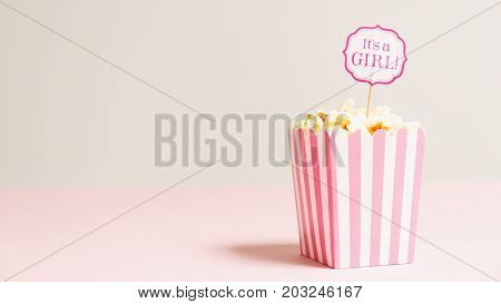 It's A Girl Sign In A Popcorn Bag At The Baby Shower Party.  Empty Background.  Baby Shower Celebrat