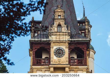 Sinaia Romania - june 21 2017: Close-up view on tower with clock of Peles castle at Sinaia town in Romania summer residence of Romanian royal family.