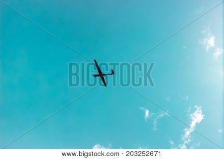 The glider gliding in the blue sky, glider flight