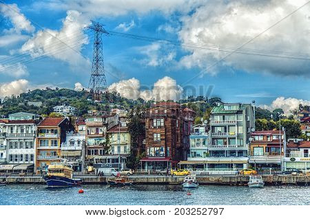 ISTANBUL, TURKEY : Boats and wooden buildings lined up by the Bosphorus channel on October 2 2014