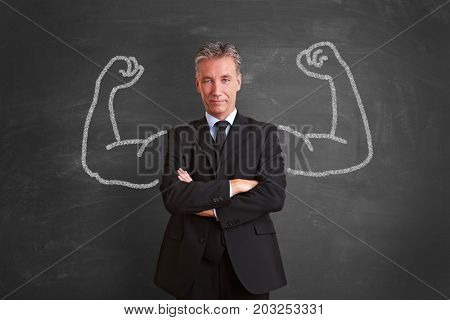 Powerful and successful businessman with chalk muscles as self confident concept