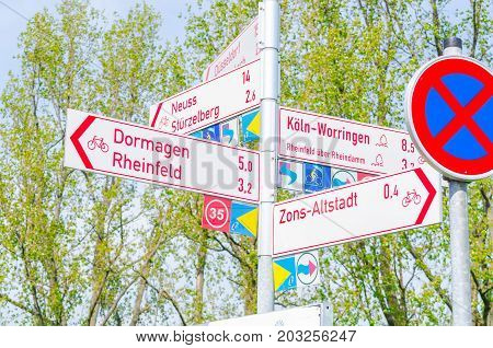 ZONS GERMANY - APRIL 24 2015: Signposts road signs on a cycle path at Zons am Rhein.