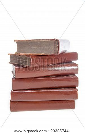Pile of untitled old leather bound books. Stack of antique literature for World Literacy day. Isolated against white background.