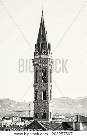 Badia Fiorentina is an abbey and church now home to the Fraternity of Jerusalem situated on the Via del Proconsolo in the centre of Florence Tuscany Italy. Travel destination. Black and white photo.