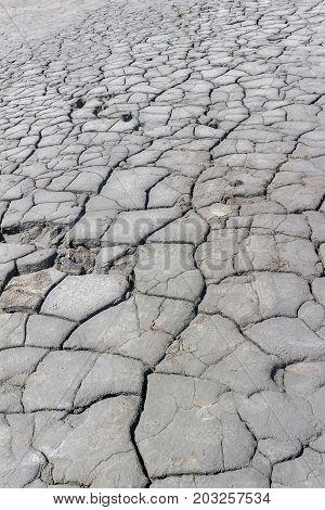 Cracked soil on terrain of muddy volcanoes at Berca in Romania.