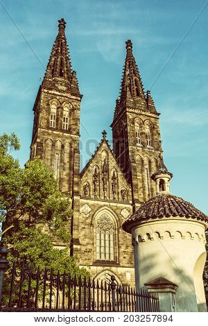 Beautiful basilica of Saint Peter and Saint Paul Vysehrad Prague Czech republic. Sunset photo. Religious architecture. Travel destination. Old photo filter.