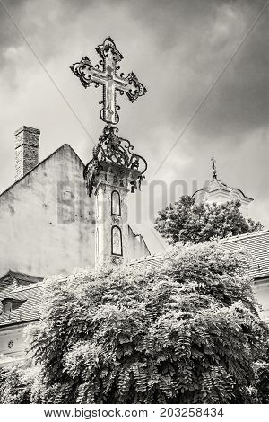 Detail of holy cross in Szentendre Hungary. Religious architecture. Place of worship. Symbolic object. Black and white photo.
