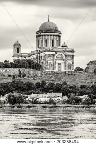 Beautiful basilica and Danube river in Esztergom Hungary. Cultural heritage. Travel destination. Place of worship. Religious architecture. Black and white photo.