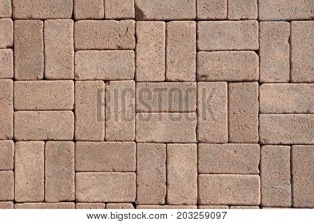 Beautiful Luxury German Vintage Ceramic Clinker Pavers for Patio as a Textured Background for Your Text. Add Your Text. Floor pavers in a path detail of a pavement to walk.