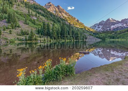 a scenic maroon bells landscape reflection in summer