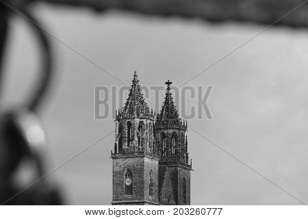 MAGDEBURG, GERMANY - SEPTEMBER 7, 2017: View of the cathedral in Magdeburg with blurred love padlocks in the front. (Magdeburg is the sister city of Nashville, USA.)
