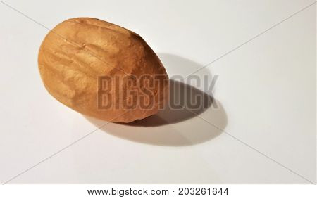 deformed chicken egg on a white background with shadows