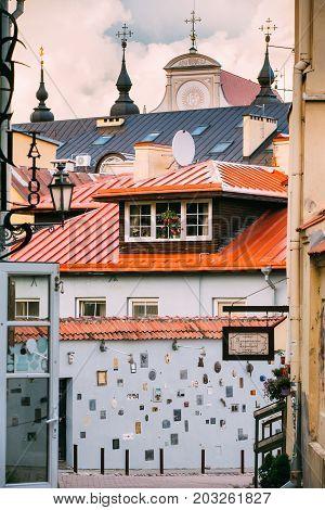Vilnius, Lithuania - July 7, 2016: Literatu Street - One Of The Oldest Streets In The Old Town Of Vilnius, Lithuania. Wall With Literary Works Of Art. Literatu Street Wall