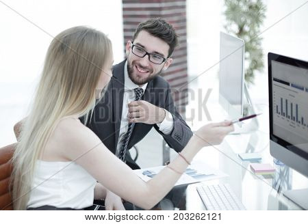Senior manager and employee discussing financial documents