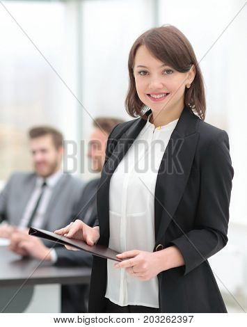 confident young business woman with documents