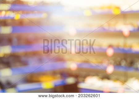 Abstract Blurred Background - Supermarket Aisle With Colorful Shelves And Goods