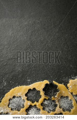 Directly above shot of flower shape mould on dough at table