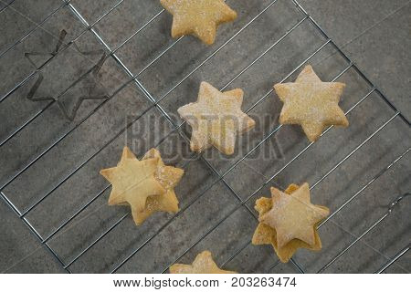 Close up of star shape cookies on cooling rack at table