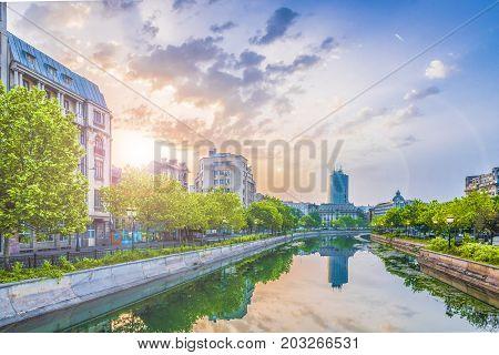 Dambovita river and center of Bucharest at sunset time Romania.