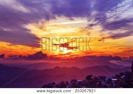 Amazing mountain landscape with colorful vivid sunset on the bright sky, natural outdoor travel background