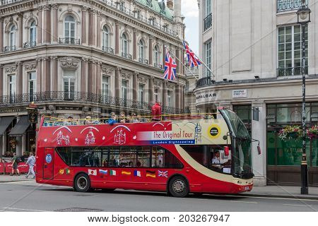 LONDON ENGLAND - JUNE 09 2017: Street view with tourists in sightseeing bus near Trafalgar Square in London UK