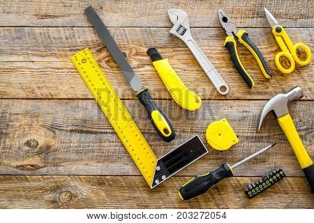 house renovation with implements set for building, painting and repair on wooden table background top view mockup
