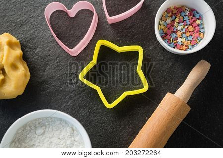 Overhead view of moulds with candies in bowl on table