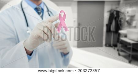 Doctor touching an digital screen  against mri scanner in room