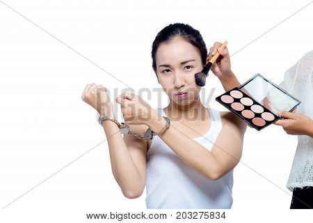 Beautiful Asian Women With Pure Face And Her Hand In Shackle,make Up Artist Brush On Her Cheek