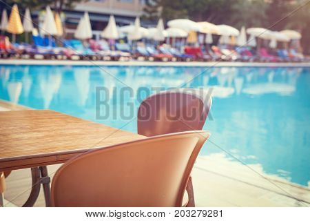 table with swimming pool view on resort hotel