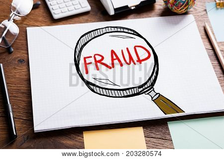 Fraud Investigation And Audit Concept Drawn In Notepad