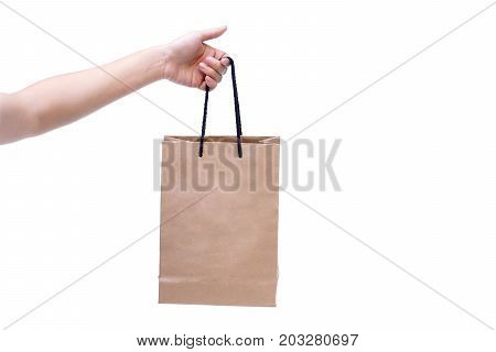 Female hand holding a paper bag isolated / Using a paper bag to save environment concept